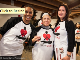 YogaCare students Nubia Ptah and Roseann Chico from classes at Chicago Family Health Center in South Chicago with substitute yoga teacher Carmen Mendoza celebrate at the Launch Party 11/19/14